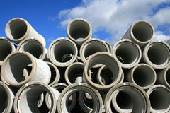 Stacked pipes and sky. An outdoor site where a lot of stacked up water pipes are placed with sky above Stock Photography