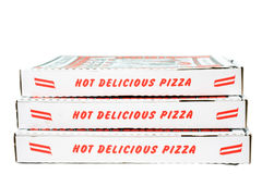 Stacked Pizza Boxes. Three stacked pizza boxes with red lettering royalty free stock images