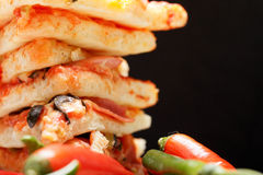 Stacked pizza and chili closeup Royalty Free Stock Image