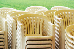 Stacked plastic chairs. Outdoors, selective focus detail Royalty Free Stock Image