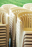 Stacked plastic chairs Royalty Free Stock Images