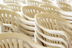 Stacked plastic chairs Stock Photography