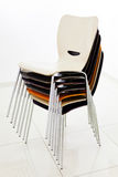 Stacked plastic chairs Stock Images
