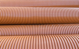 Stacked plastic polyethylene pipes Stock Images
