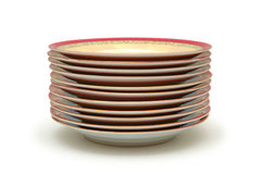 Stacked plates. Isolated on white royalty free stock images