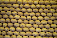 Stacked potatoes. On the market royalty free stock photos