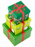 Stacked Presents. Three christmas presents stacked and isolated on white Stock Photography