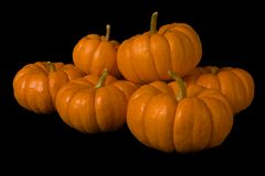Stacked Pumpkins. Six stacked orange pumpkins, isolated on a black background Royalty Free Stock Photos