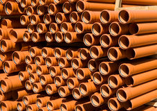 Stacked PVC  orange pipes Stock Image