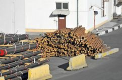 Stacked PVC pipe and lumber Royalty Free Stock Photography