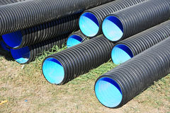 Stacked PVC pipe. Stacked new PVC pipe on construction site Royalty Free Stock Photos