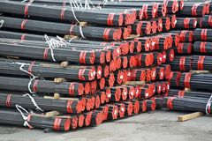 Stacked PVC and steel pipe Royalty Free Stock Photo