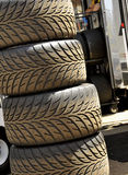 Stacked Race Car Tyres. Stacked Formula One Race Car Tyres in Pit Stop Royalty Free Stock Photos