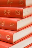 Stacked Red Books (Close View). Closed view on stacked Encyclopedia Royalty Free Stock Photos