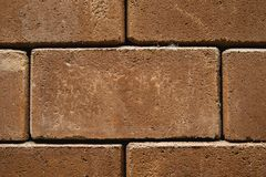 Stacked red brick strong world stock images
