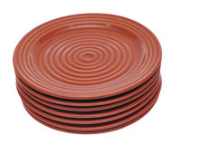 Stacked red brown plates Royalty Free Stock Photos