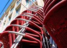 Stacked red chairs. Low angle view of stack of red wicker chairs Stock Images