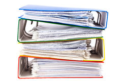 Stacked red, green, blue and yellow office folders Royalty Free Stock Images
