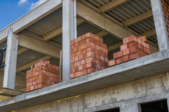 Stacked red hollow clay blocks for building block walls Stock Image