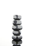 Stacked reflective stones Stock Image