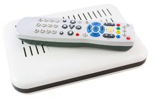 Stacked Remote and Receiver for Internet TV on white side view Stock Photography