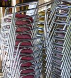 Stacked restaurant chairs Royalty Free Stock Images