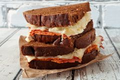 Stacked Reuben Sandwiches against white wood Royalty Free Stock Photo