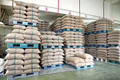 Stacked of Rice sacks in warehouse. Stock Images