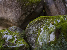 Stacked rock boulders with moss Royalty Free Stock Photography