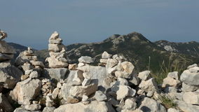 Stacked rock towers on mountain top for spiritual purposes - camera pan. Stacked rock towers on mountain top for meditation, worship, remebrance or other stock video footage