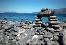 Stacked rocks on black rock island at Ko Lipe national park in Thailand stock photography