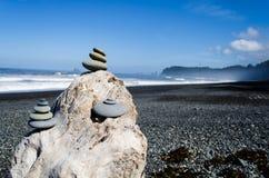 Stacked rocks on the coast. Stacked rocks on the west coast on Rialto Beach, Olympic National Park, Washington, USA Royalty Free Stock Photography