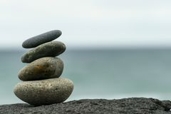 Stacked rocks inuksuk at the beach. Stacked rocks also known as an Inuksuk in Canada, stacked on the beach in San Diego, California Royalty Free Stock Photography