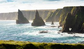 Stacked Rocks,  Northern Scotland. Duncansby Stacks at the northernmost tip of North East Scotland. John O Groats. Famous tourist spot. Set under big dramatic Stock Photos