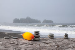 Stacked rocks and orange football Royalty Free Stock Photography