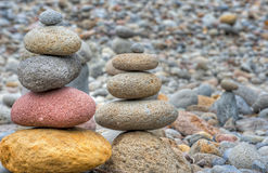 Stacked Rocks At Oxbow Park. At Oxbow Park, along the Sandy River, has a beach where rocks are staked by anyone who visits the area creating a village of stacked Royalty Free Stock Photography