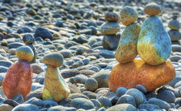 Stacked Rocks At Oxbow Park. At Oxbow Park, along the Sandy River, has a beach where rocks are staked by anyone who visits the area creating a village of stacked Stock Images