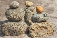 Stacked Rocks At Oxbow Park. At Oxbow Park, along the Sandy River, has a beach where rocks are staked by anyone who visits the area creating a village of stacked Royalty Free Stock Photo