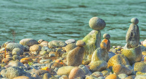 Stacked Rocks At Oxbow Park. At Oxbow Park, along the Sandy River, has a beach where rocks are staked by anyone who visits the area creating a village of stacked Royalty Free Stock Photos