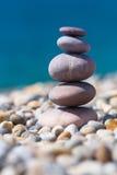 Stacked rocks on pebble beach Stock Photo