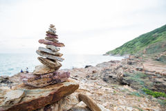 Stacked rocks represent balance and harmony on the coast Royalty Free Stock Photography