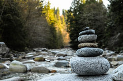 Zen stones stacked on river scene Stock Images