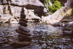 Stacked rocks by the river Royalty Free Stock Image