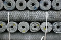 Stacked Rolls of Chicken Wire Royalty Free Stock Images