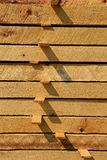 Rough sawed dimensional limber. Stacked rough sawed dimensional lumber is piled with laths allowing for circulation and drying Royalty Free Stock Photography
