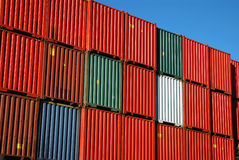 Stacked shipping containers. A picture of shipping containers, stacked up high in a port stock photography
