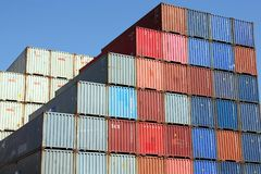 Stacked Shipping Containers and blue sky Stock Photos