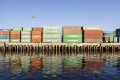 Stacked Shipping Containers on Dock Stock Images