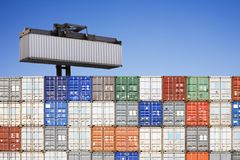 Shipping Container Above Stacked Others Royalty Free Stock Images