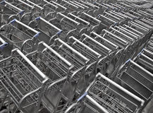 Stacked shopping carts. Stacked silver shopping carts background stock photos